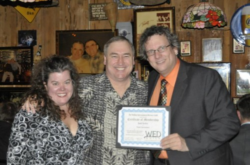Peter Merry & Elisabeth Scott Daley presenting Randy Bartlett with his WED Guild® Membership Certificate