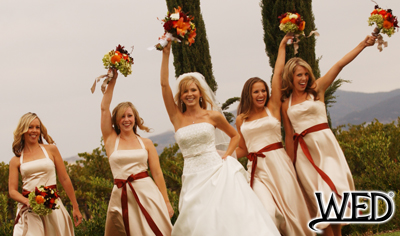wedding reception bride and bridesmaids with their bouquets held high and Wedding Entertainment Director® logo