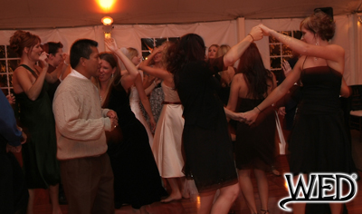 wedding reception guests dancing on the dance floor and Wedding Entertainment Director® logo