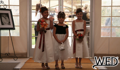 wedding reception flower girls smiling during their grand entrance and Wedding Entertainment Director® logo
